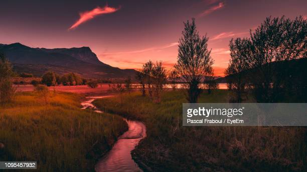 scenic view of field against sky during sunset - embrun stock pictures, royalty-free photos & images