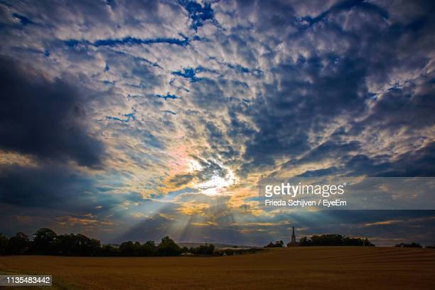 scenic view of field against sky during sunset - troyes champagne ardenne photos et images de collection