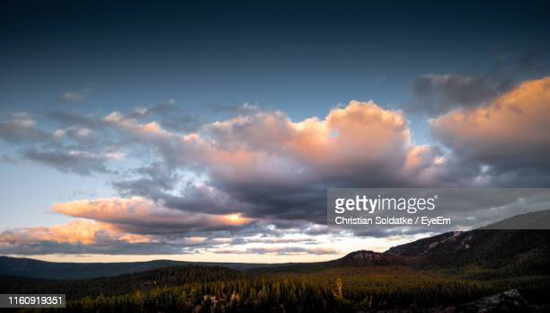 scenic view of field against sky during sunset - christian soldatke stock pictures, royalty-free photos & images