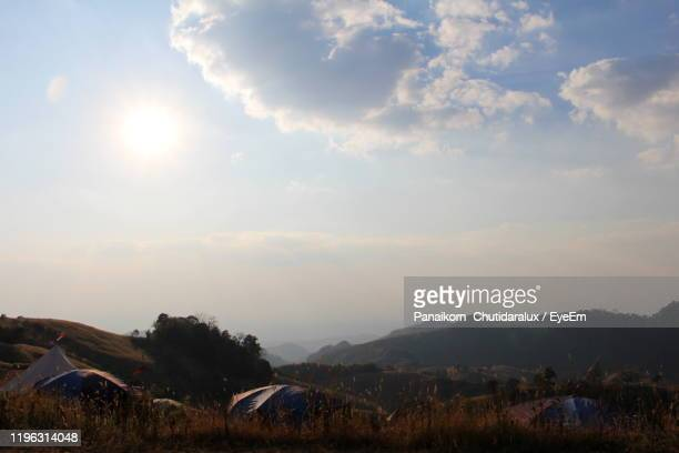 scenic view of field against sky during sunset - panaikorn chutidaralux stock photos and pictures