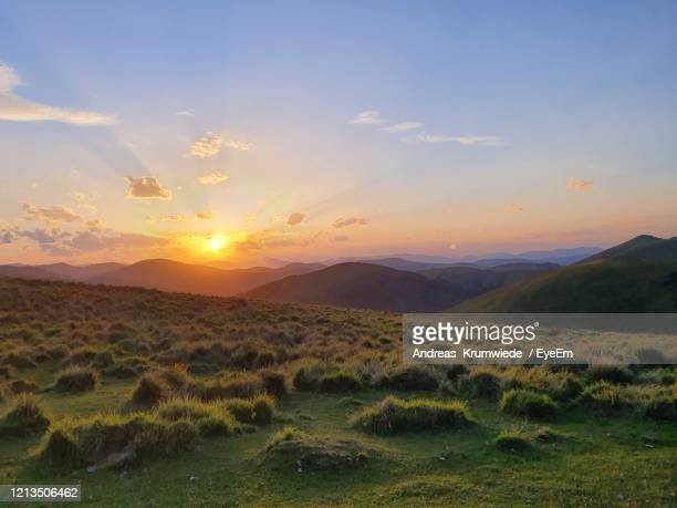 scenic view of field against sky during sunset - andreas solar stock pictures, royalty-free photos & images
