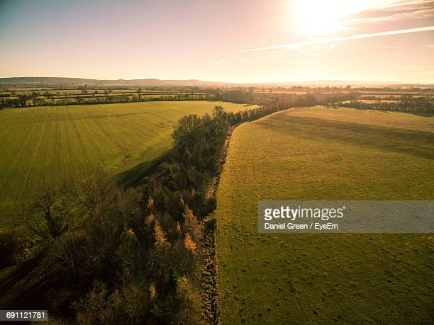 scenic view of field against sky during sunset - aylesbury stock photos and pictures