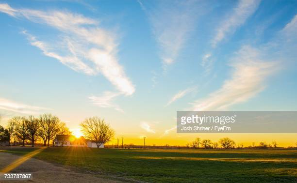 scenic view of field against sky during sunset - oklahoma city stock pictures, royalty-free photos & images