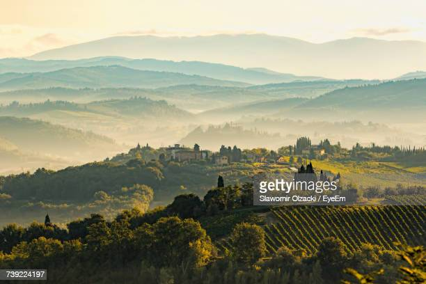 scenic view of field against sky during sunset - volterra stock photos and pictures