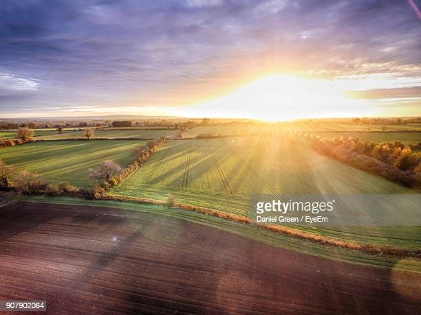 scenic view of field against sky during sunset - buckinghamshire stock pictures, royalty-free photos & images