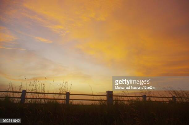 scenic view of field against sky during sunset - muhamad nasrun stock pictures, royalty-free photos & images