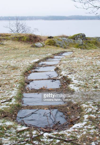 scenic view of field against sky during winter - slush stock photos and pictures