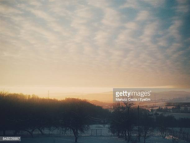 scenic view of field against sky in morning during winter - kraków ストックフォトと画像