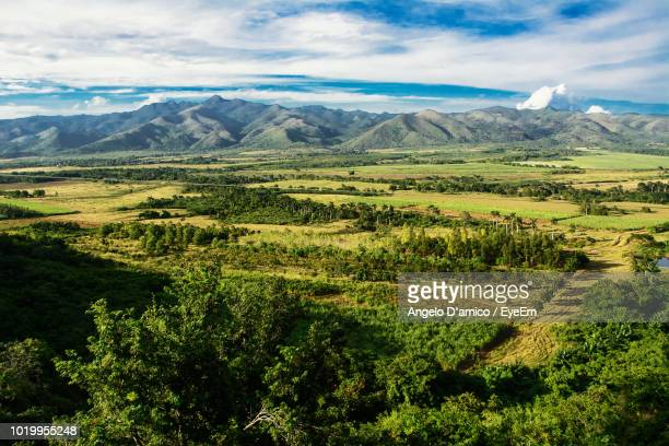scenic view of field against sky - valley stock pictures, royalty-free photos & images