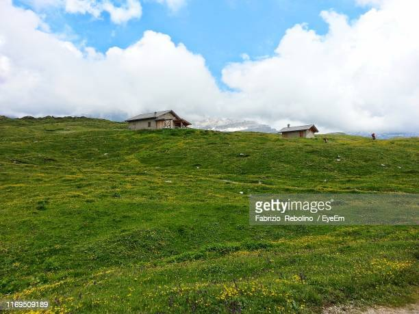 scenic view of field against sky - fabrizio villa stock pictures, royalty-free photos & images