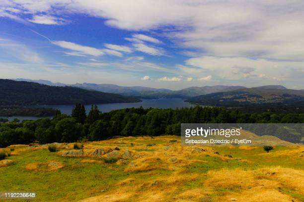 scenic view of field against sky - lake windermere stock pictures, royalty-free photos & images