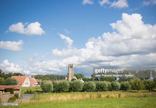 scenic view of field against sky - damme stock pictures, royalty-free photos & images