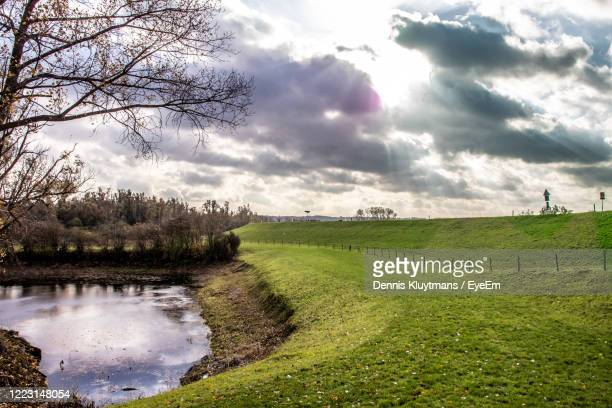 scenic view of field against sky - nijmegen stock pictures, royalty-free photos & images