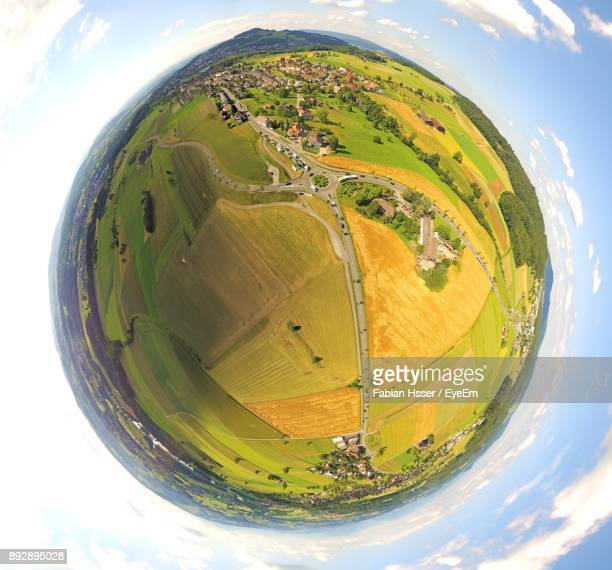 scenic view of field against sky - fish eye lens stock pictures, royalty-free photos & images