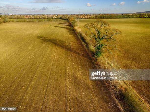 scenic view of field against sky - aylesbury stock photos and pictures
