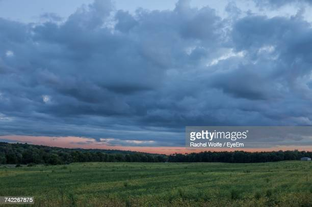 scenic view of field against storm clouds - rachel wolfe stock pictures, royalty-free photos & images