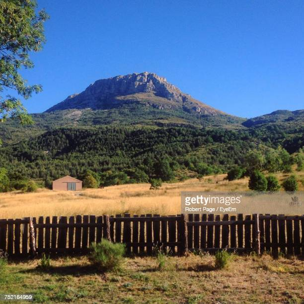 scenic view of field and mountains against clear sky - alpes de haute provence stock photos and pictures