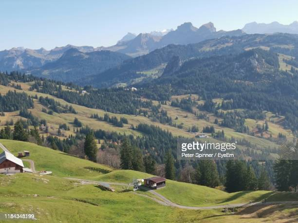 scenic view of field and mountains against sky - schwyz stock pictures, royalty-free photos & images
