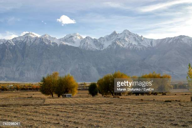 scenic view of field and mountains against sky - marek stefunko stock photos and pictures