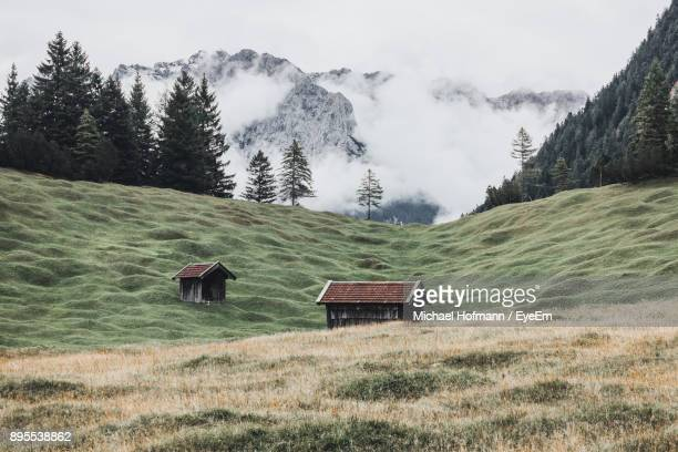scenic view of field and mountains against sky - mittenwald stock pictures, royalty-free photos & images