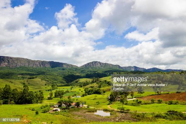 scenic view of field and mountains against sky - minas gerais state stock pictures, royalty-free photos & images