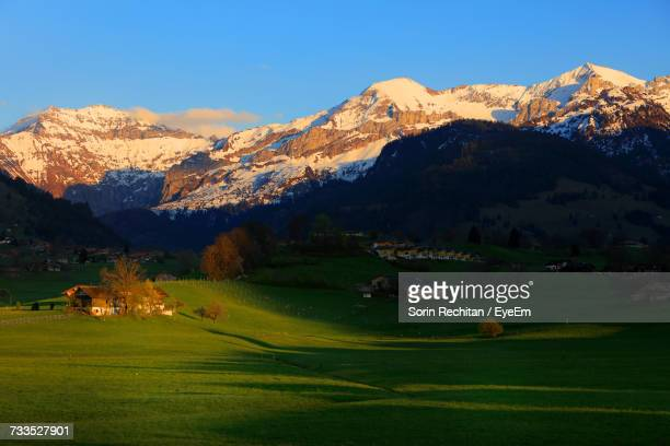 Scenic View Of Field And Mountains During Winter