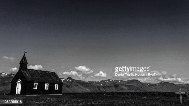 scenic view of field by mountains against sky - hutton stock photos and pictures