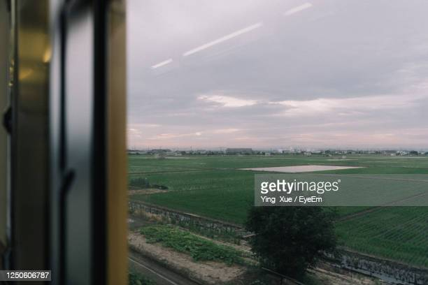scenic view of field seen through train window - changzhou stock pictures, royalty-free photos & images