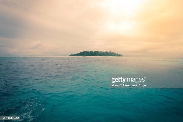 Scenic View Of Fiji Island Against Sky At Sunset