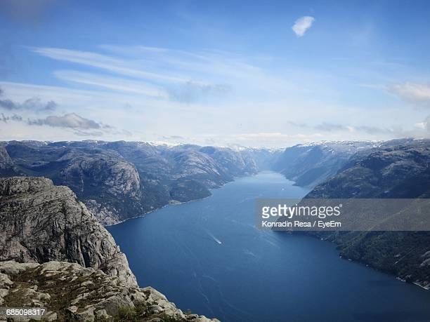 Scenic View Of Fjord Amidst Cliffs Against Sky
