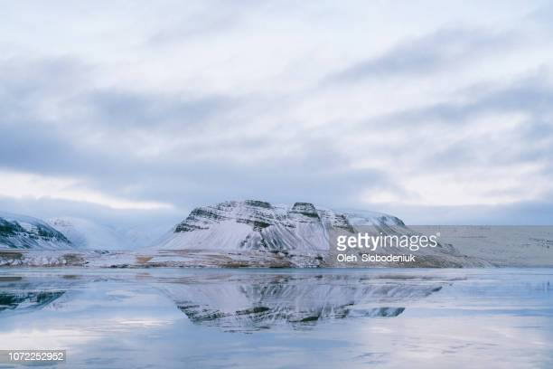 scenic view of fjord in winter at sunset in iceland - north pole stock pictures, royalty-free photos & images