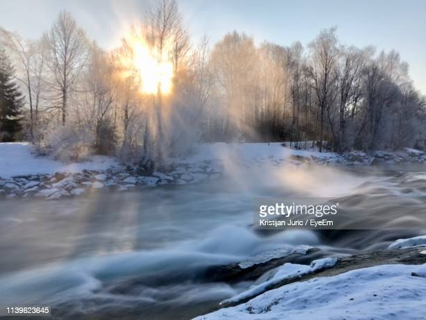 scenic view of flowing river during winter - lenggries stock pictures, royalty-free photos & images