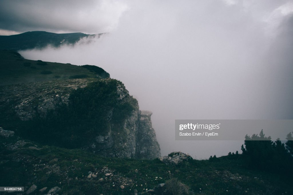 Scenic View Of Foggy Cliff : Stock Photo