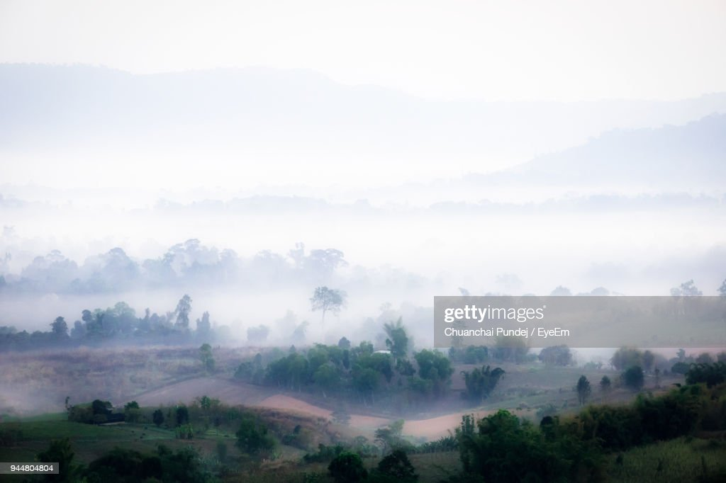 Scenic View Of Foggy Landscape Against Sky : Stock Photo