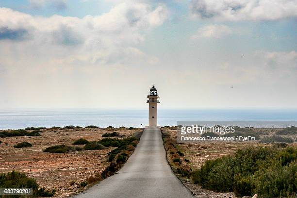 Scenic View Of Footpath Leading To Lighthouse