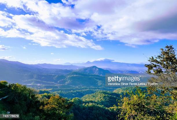 scenic view of forest and mountains against sky - el salvador stock pictures, royalty-free photos & images