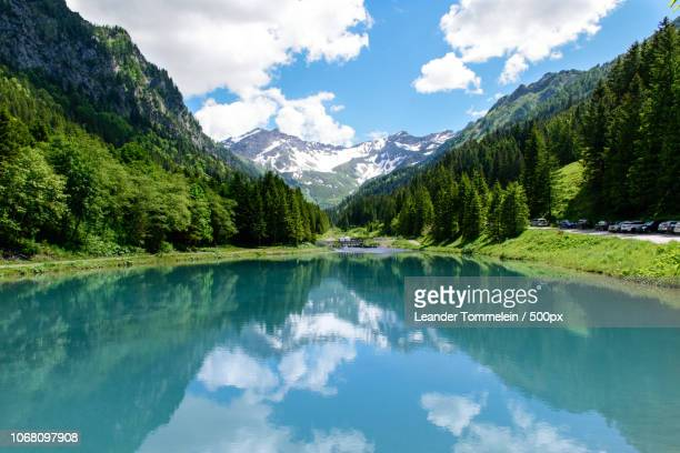 scenic view of forest and mountains reflected in lake - liechtenstein stock pictures, royalty-free photos & images