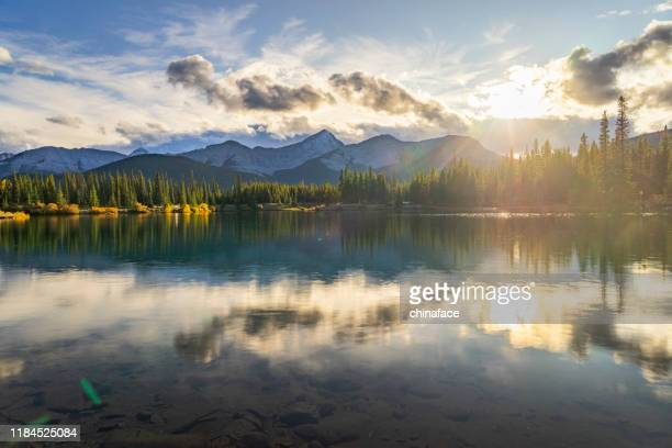 scenic view of forget-me-not pond at twilight - kananaskis country stock pictures, royalty-free photos & images
