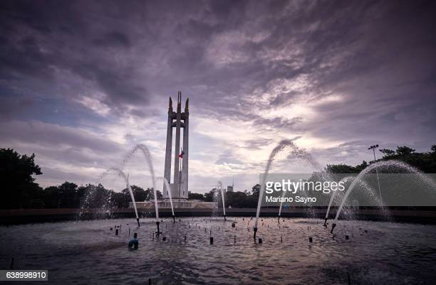 scenic view of fountain in front of monument against sky - philippines flag stock pictures, royalty-free photos & images