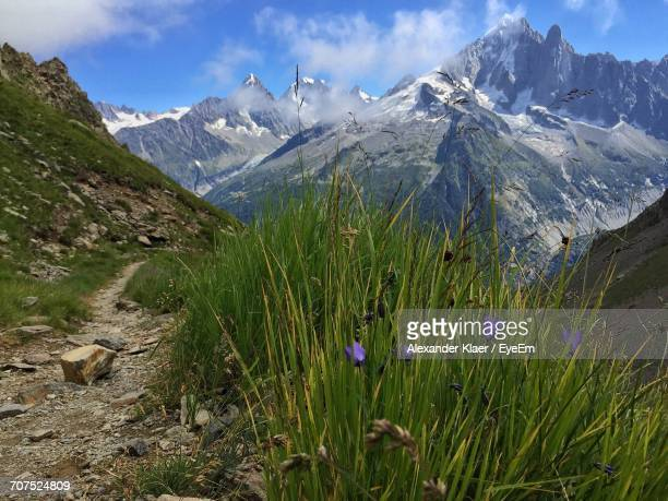scenic view of fresh mountains against sky - rhone alpes stock photos and pictures
