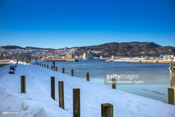 Scenic View Of Frozen Lake Against Clear Blue Sky