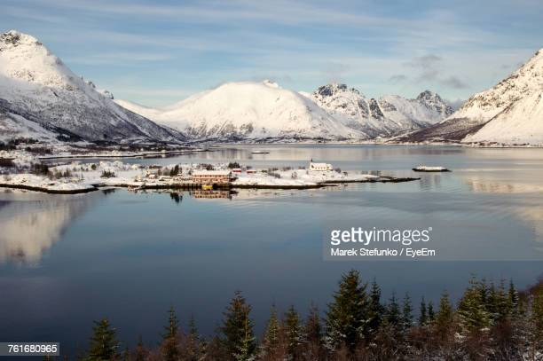 scenic view of frozen lake against mountain range - marek stefunko stockfoto's en -beelden