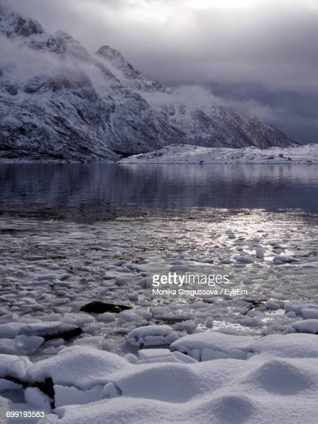 scenic view of frozen lake against sky during sunset - monika gregussova stock pictures, royalty-free photos & images