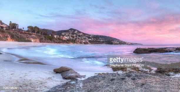 scenic view of frozen lake against sky during sunset - treasure island california stock pictures, royalty-free photos & images