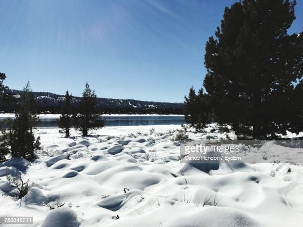 scenic view of frozen lake against sky during winter - big bear lake stock photos and pictures