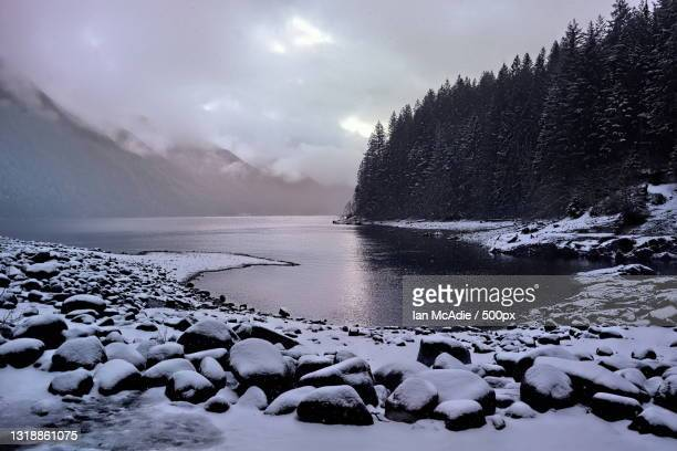 scenic view of frozen lake against sky during winter,british columbia,canada - extreme terrain stock pictures, royalty-free photos & images