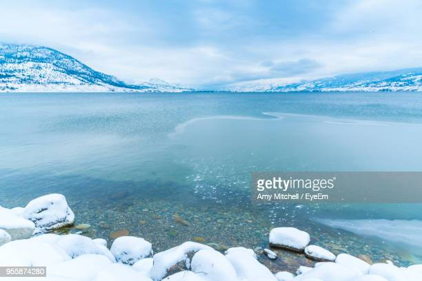 scenic view of frozen lake against sky - amy freeze stock pictures, royalty-free photos & images