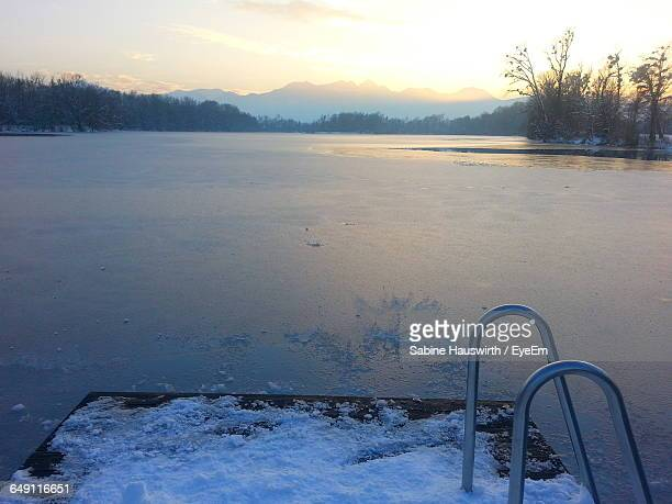 scenic view of frozen lake during sunset - sabine hauswirth stock pictures, royalty-free photos & images