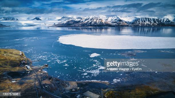 scenic view of frozen lake - svalbard and jan mayen stock pictures, royalty-free photos & images