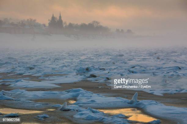 scenic view of frozen land against sky during sunset - zinchenko stock pictures, royalty-free photos & images